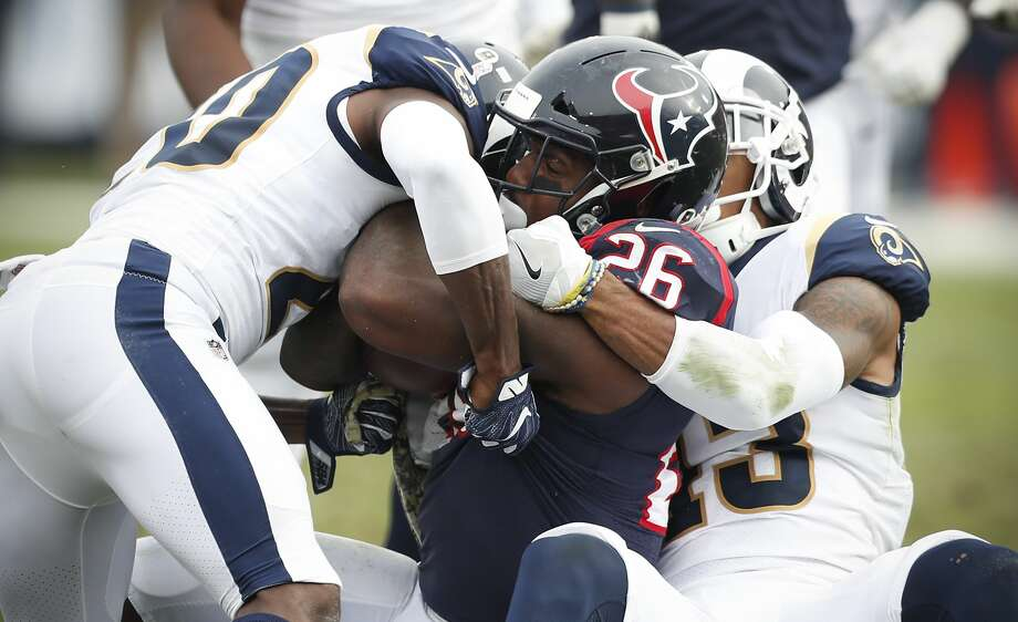 Houston Texans running back Lamar Miller (26) is stopped by Los Angeles Rams free safety Lamarcus Joyner (20) and strong safety John Johnson (43) during the second quarter of an NFL football game at the Los Angeles Memorial Coliseum on Sunday, Nov. 12, 2017, in Los Angeles, Mass. ( Brett Coomer / Houston Chronicle ) Photo: Brett Coomer/Houston Chronicle