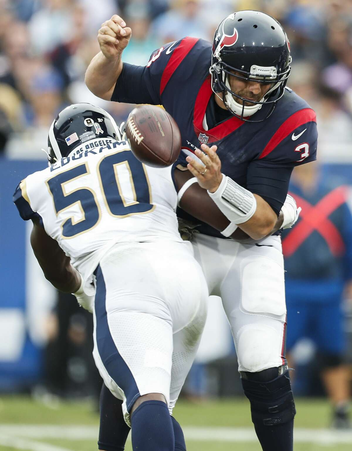 Houston Texans quarterback Tom Savage (3) fumbles as he is hit by Los Angeles Rams linebacker Samson Ebukam (50), resulting in a turnover, during the third quarter of an NFL football game at the Los Angeles Memorial Coliseum on Sunday, Nov. 12, 2017, in Los Angeles. ( Brett Coomer / Houston Chronicle )