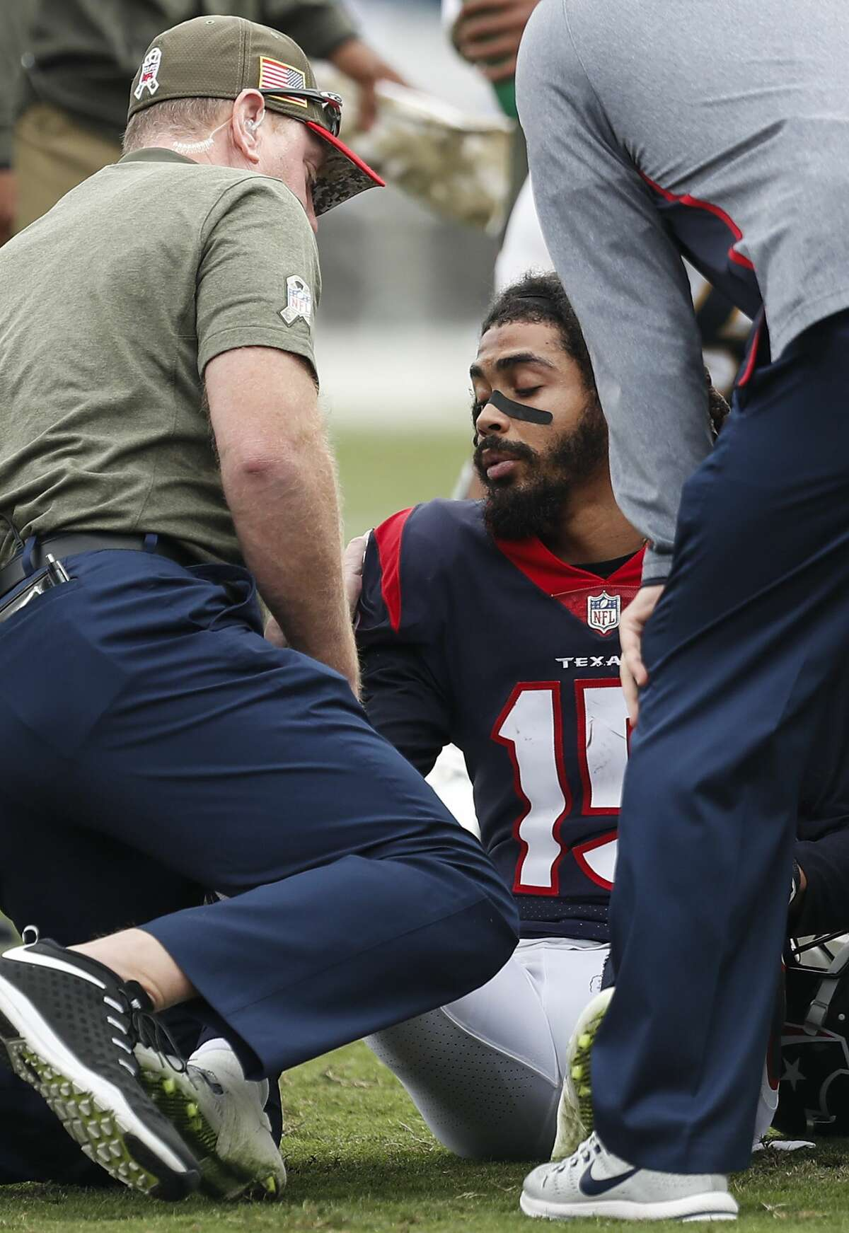 Houston Texans wide receiver Will Fuller (15) is tenddd to by trainer Geoff Kaplan after suffering an injury against the Los Angeles Rams during the second quarter of an NFL football game at the Los Angeles Memorial Coliseum on Sunday, Nov. 12, 2017, in Los Angeles, Mass. ( Brett Coomer / Houston Chronicle )