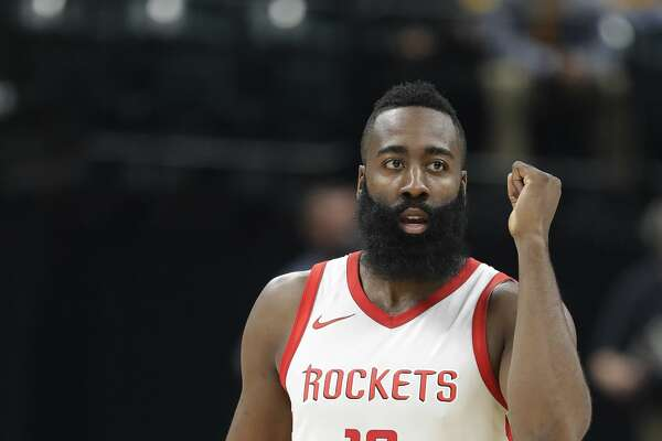 Houston Rockets' James Harden reacts after a basket during the second half of an NBA basketball game against the Indiana Pacers, Sunday, Nov. 12, 2017, in Indianapolis. (AP Photo/Darron Cummings)
