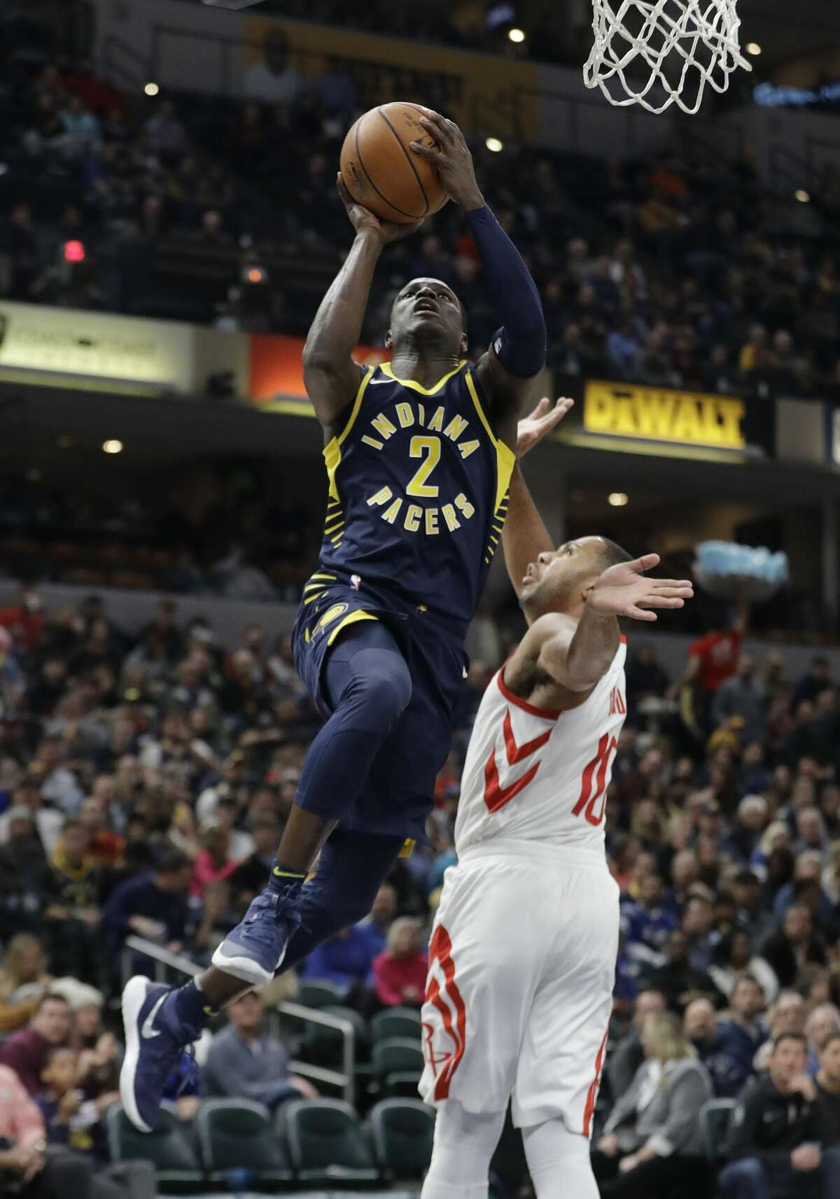Indiana Pacers' Darren Collison (2) puts up a shot against Houston Rockets' Eric Gordon (10) during the second half of an NBA basketball game, Sunday, Nov. 12, 2017, in Indianapolis. Houston won 118-95. (AP Photo/Darron Cummings)