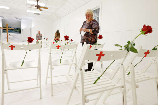 Sutherland Springs resident Helen Biesenbach visits the First Baptist Church of Sutherland Springs Memorial Sunday Nov. 12, 2017. Twenty-six people were killed at the church last Sunday during a shooting.