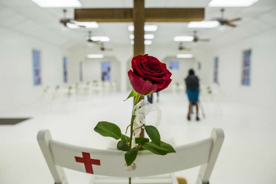 Roses mark the chairs that bear the names of the 26 people killed by a gunman Nov. 5, 2017, at First Baptist Church in Sutherland Springs, Texas. The church was transformed for a memorial service held on Nov. 12, 2017. Photo: DREW ANTHONY SMITH/NYT