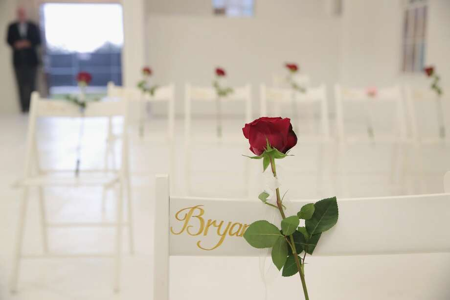 SUTHERLAND SPRINGS, TX - NOVEMBER 12:  The First Baptist Church of Sutherland Springs is turned into a memorial to honor those who died on November 12, 2017 in Sutherland Springs, Texas. The inside of the church has been painted white with 26 white chairs placed around the room. On each chair is a single rose and the name of a shooting victim. The chairs are placed throughout the room at the location where the victim died. The memorial will be open to the public. Devin Patrick Kelley shot and killed the 26 people and wounded 20 others when he opened fire during Sunday service at the church on November 5th.  (Photo by Scott Olson/Getty Images) Photo: Scott Olson/Getty Images