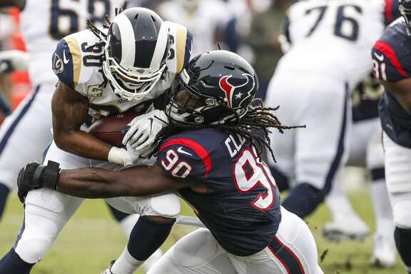 Houston Texans outside linebacker Jadeveon Clowney (90) stops Los Angeles Rams running back Todd Gurley (30) for a loss during the first quarter of an NFL football game at the Los Angeles Memorial Coliseum on Sunday, Nov. 12, 2017, in Los Angeles, Mass. ( Brett Coomer / Houston Chronicle )