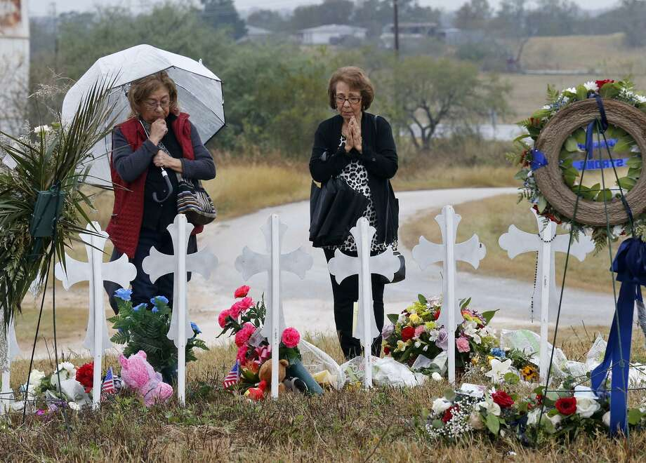 Gloria Krause (left) and Belinda Murguia, both from San Antonio, pray, Sunday Nov. 12, 2017, at the 26 crosses for those killed in the mass shooting at the First Baptist Church of Sutherland Springs. Photo: Edward A. Ornelas, Staff / San Antonio Express-News / © 2017 San Antonio Express-News
