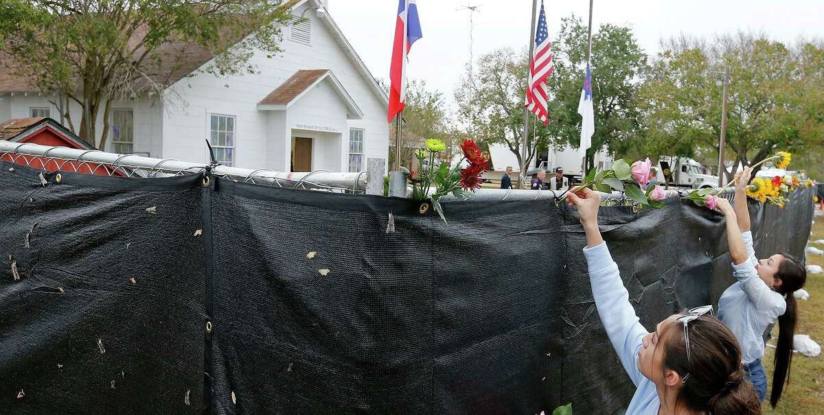 Visitors place flowers on the fence outside the First Baptist Church of Sutherland Springs in 2017. Twenty-six people were killed by a gunman at the church; the mass shooting is the subject of a new documentary.