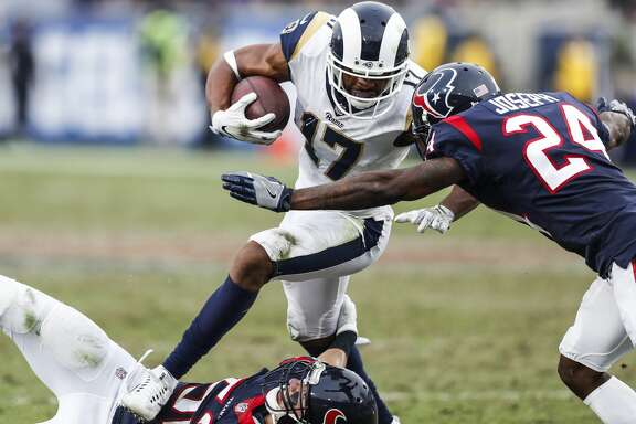 Los Angeles Rams wide receiver Robert Woods (17) runs between Houston Texans linebacker Brian Peters (52) and cornerback Johnathan Joseph (24) during the fourth quarter of an NFL football game at the Los Angeles Memorial Coliseum on Sunday, Nov. 12, 2017, in Los Angeles, Mass. ( Brett Coomer / Houston Chronicle )