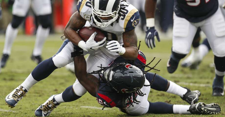 Houston Texans outside linebacker Jadeveon Clowney (90) tackles Los Angeles Rams running back Todd Gurley (30) for a loss during the first quarter of an NFL football game at the Los Angeles Memorial Coliseum on Sunday, Nov. 12, 2017, in Los Angeles. ( Brett Coomer / Houston Chronicle ) Photo: Brett Coomer/Houston Chronicle