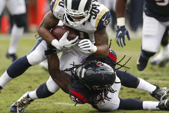 Houston Texans outside linebacker Jadeveon Clowney (90) tackles Los Angeles Rams running back Todd Gurley (30) for a loss during the first quarter of an NFL football game at the Los Angeles Memorial Coliseum on Sunday, Nov. 12, 2017, in Los Angeles. ( Brett Coomer / Houston Chronicle )