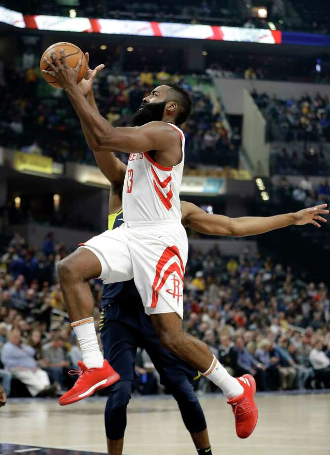James Harden leaves Thaddeus Young and the Pacers in his dust during Sunday's game. The Rockets guard scored 26 points and added 15 assists. Photo: Darron Cummings, STF / Copyright 2017 The Associated Press. All rights reserved.