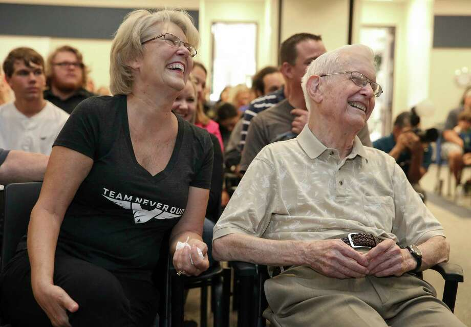 Kathy Walker and her father, U.S. Army Air Corps World War II veteran William Fly, celebrate Fly's 100th birthday at Cypress Creek Education Center. Fly lost his wife three months before Hurricane Harvey flooded his home and made it unlivable. Photo: Yi-Chin Lee, Staff / © 2017 Houston Chronicle