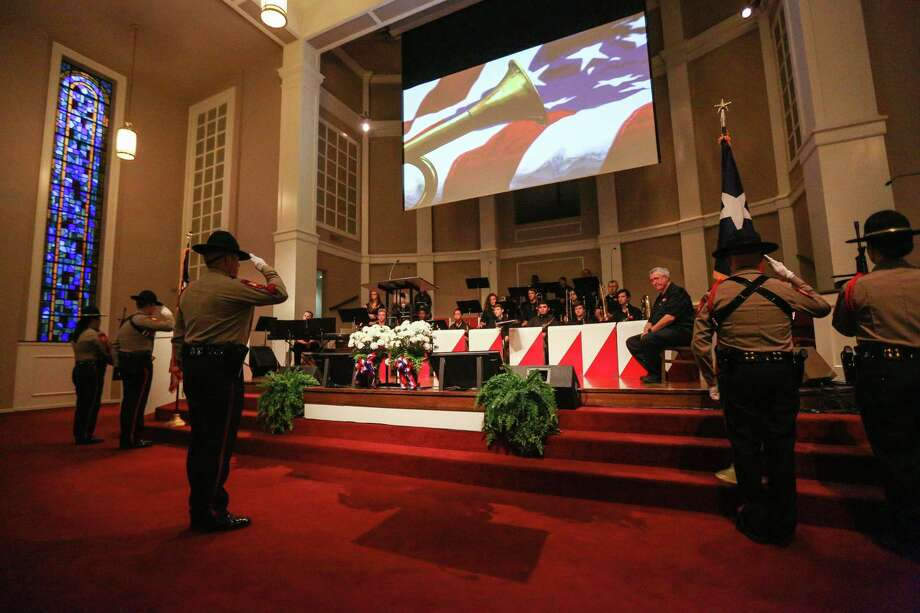 The Montgomery County Sheriff's Office Honor Guard retires the U.S. and Texas flags during the decommissioning ceremony for the Montgomery County Veterans Memorial on Sunday, Nov. 12, 2017, at First Baptist Church in Conroe. Photo: Meagan Ellsworth, Staff / © 2017 Houston Chronicle