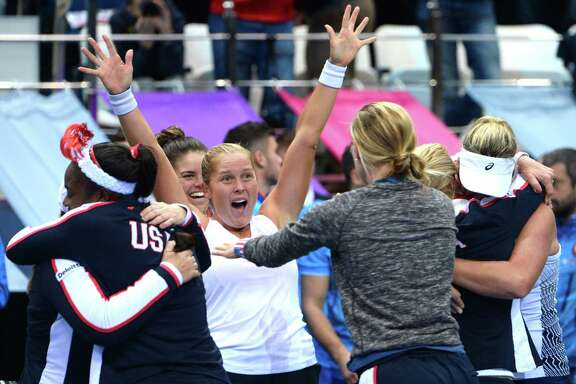 Shelby Rogers, center, and her U.S. teammates have a lot to celebrate after the Americans won the Fed Cup final over Belarus and ended a 17-year title drought.