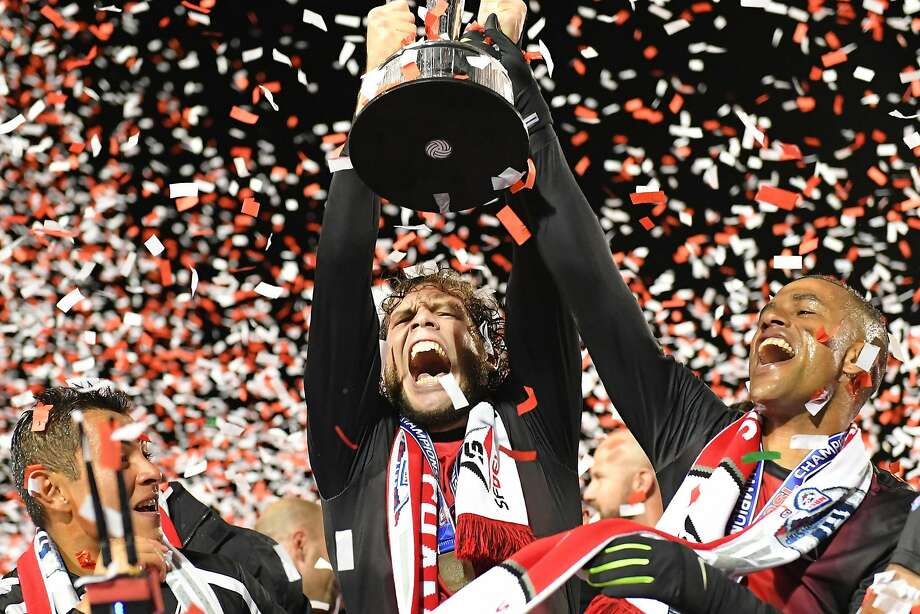 S.F. Deltas forward Tommy Heinemann holds the NASL championship trophy alongside defender Reiner Ferreira after defeating the New York Cosmos on Sunday night at Kezar Stadium Photo: Rob Edwards / San Francisco Deltas, Robert Edwards-KLC Fotos