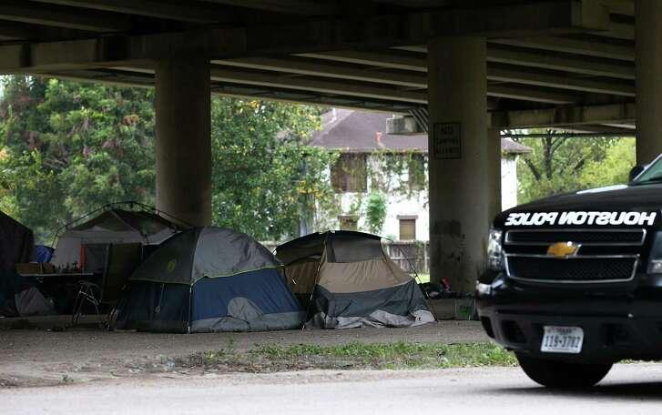 Tents dot a homeless encampment near downtown Houston. ( Godofredo A. Vasquez / Houston Chronicle )