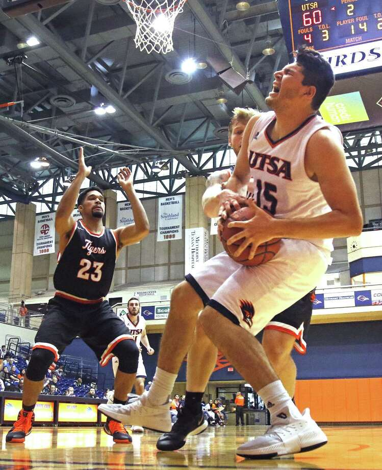 RoadrunnersÕ Adrian Rodriguez is injured on this play in UTSA basketball home opener vs East Central on Sunday, November 12, 2017. Photo: Ron Cortes, Freelance / For The San Antonio Express-News