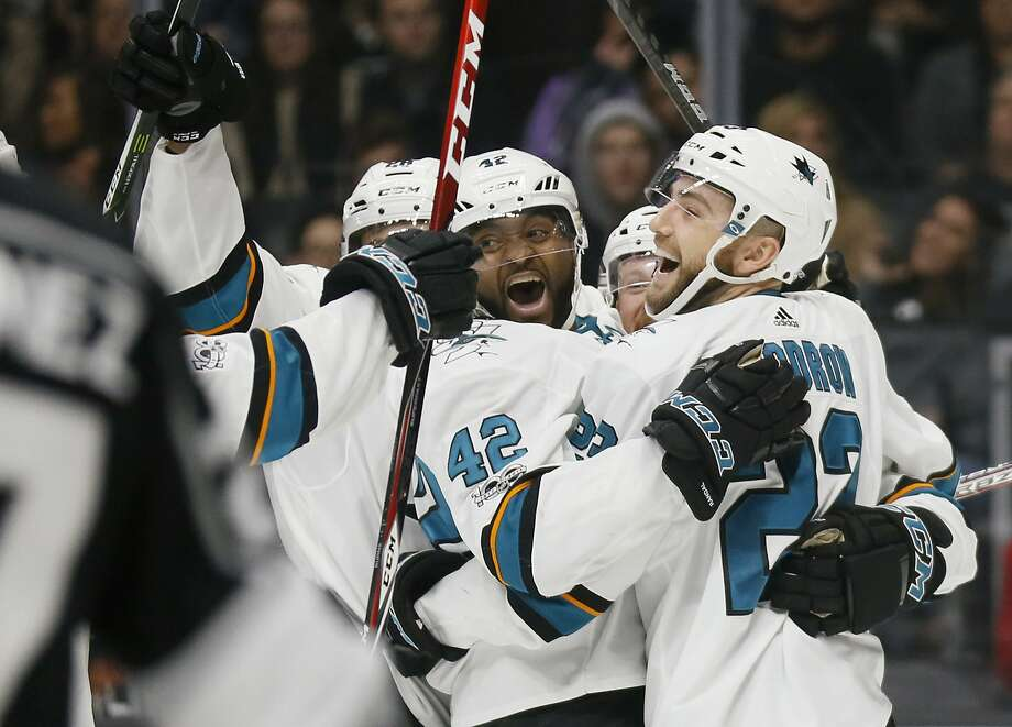San Jose Sharks right wing Joel Ward, center, celebrates his goal with teammates including right wing Barclay Goodrow, right, against the Los Angeles Kings during the third period of an NHL hockey game, Sunday, Nov. 12, 2017, in Los Angeles. (AP Photo/Danny Moloshok) Photo: Danny Moloshok, Associated Press