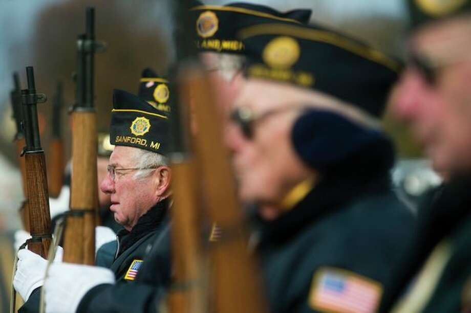 In honor of their service 				The Midland Area Veterans Honor Guard give a 21-gun salute during a Veterans Day ceremony Saturday morning in front of the Veterans Memorial near the Midland County Courthouse. More photos on page 3A. (Katy Kildee/kkildee@mdn.net)