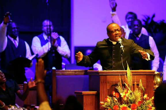 Rev. Dr. Marcus D. Cosby, Senior Pastor gives his sermon during church services at Wheeler Baptist Church on Sunday, Nov. 12, 2017, in Houston.