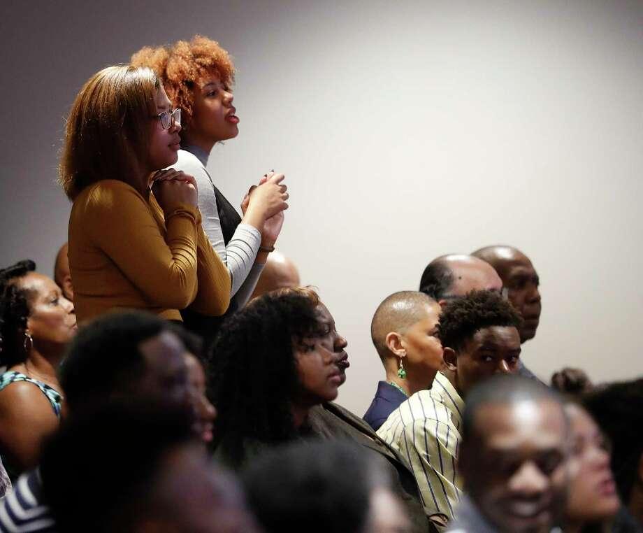 Women stand in reverence during church services at Wheeler Baptist Church on Sunday, Nov. 12, 2017, in Houston. Photo: Karen Warren, Houston Chronicle / © 2017 Houston Chronicle