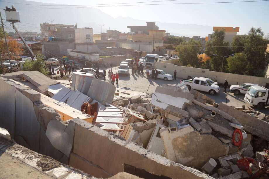 Collapsed buildings are seen in Derbendihan district of Sulaymaniyah, Iraq on November 13, 2017 following a 7.3 magnitude earthquake that hit the Iraq and Iran. An earthquake measuring 7.3 on the Richter scale rocked northern Iraq and Iran, the U.S. Geological Survey said on Sunday evening. Turkish paramedic teams and rescue teams dispatched to the disaster area under the coordination of Turkish aid agencies; AFAD (Turkey's Disaster Management Agency) and Kizilay (Turkish Red Crescent). At least 211 died and 2,504 others were injured in Iran's bordering regions, especially in Kermanshah province in west. Photo: Yunus Keles/Anadolu Agency/Getty Images