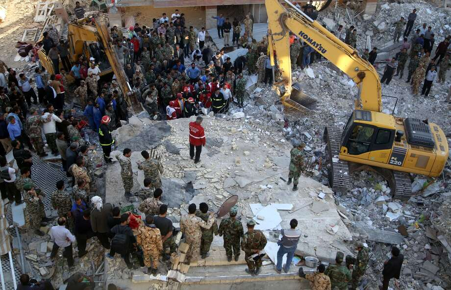 Search and rescue operations continues at Sarpol-e Zahab province of Kermanshah, Iran on November 13, 2017 following a 7.3 magnitude earthquake that hit the Iraq and Iran. An earthquake measuring 7.3 on the Richter scale rocked northern Iraq and Iran, the U.S. Geological Survey said on Sunday evening. At least 341 died and 5,953 others were injured in Iran's bordering regions, especially in Kermanshah province in west. Photo: Anadolu Agency/Getty Images