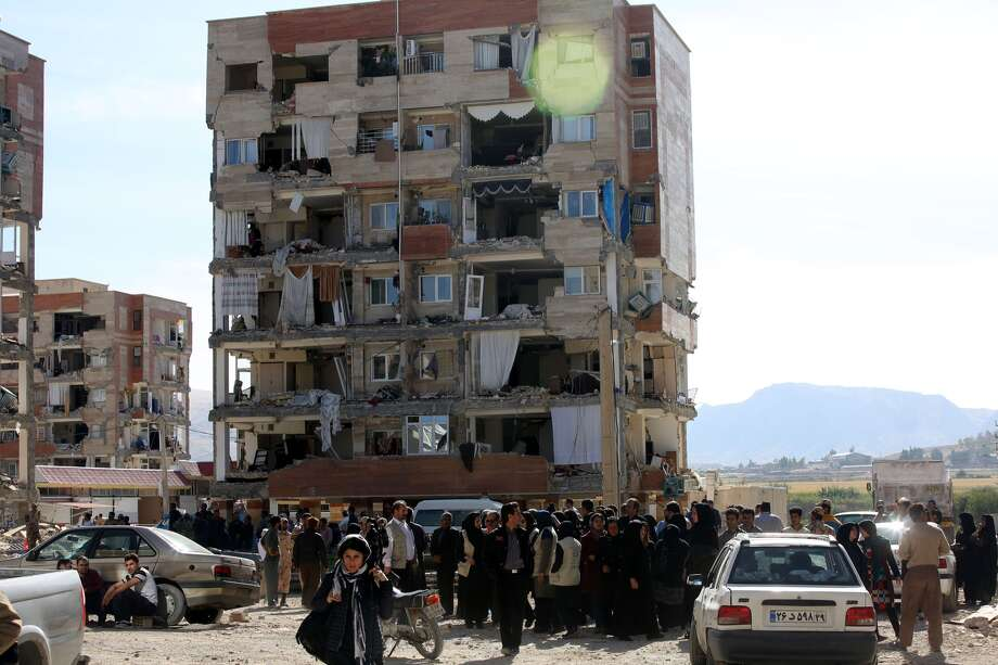 Earthquake survivors mourn for the victims in Sarpol-e Zahab town of Kermanshah, Iran on November 13, 2017 following a 7.3 magnitude earthquake that hit the Iraq and Iran. An earthquake measuring 7.3 on the Richter scale rocked northern Iraq and Iran, the U.S. Geological Survey said on Sunday evening. Turkish paramedic teams and rescue teams dispatched to the disaster area under the coordination of Turkish aid agencies; AFAD (Turkey's Disaster Management Agency) and Kizilay (Turkish Red Crescent). At least 211 died and 2,504 others were injured in Iran's bordering regions, especially in Kermanshah province in west. Photo: Fatemeh Bahrami/Anadolu Agency/Getty Images