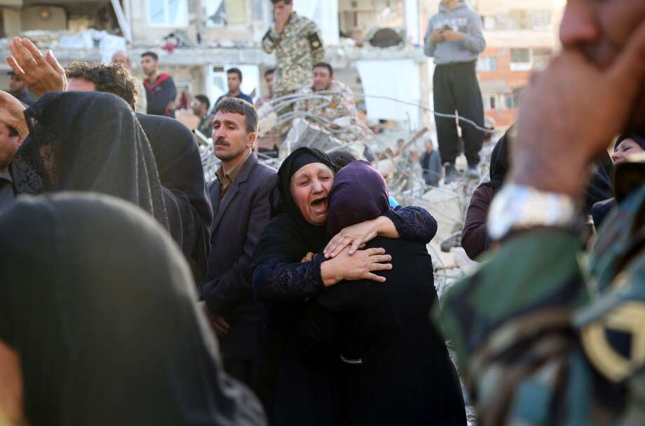 Earthquake survivors who had lost their relatives cry next to the debris of buildings at Sarpol-e Zahab province of Kermanshah, Iran on November 13, 2017 following a 7.3 magnitude earthquake that hit the Iraq and Iran. An earthquake measuring 7.3 on the Richter scale rocked northern Iraq and Iran, the U.S. Geological Survey said on Sunday evening. At least 341 died and 5,953 others were injured in Iran's bordering regions, especially in Kermanshah province in west. Photo: Fatemeh Bahrami/Anadolu Agency/Getty Images)