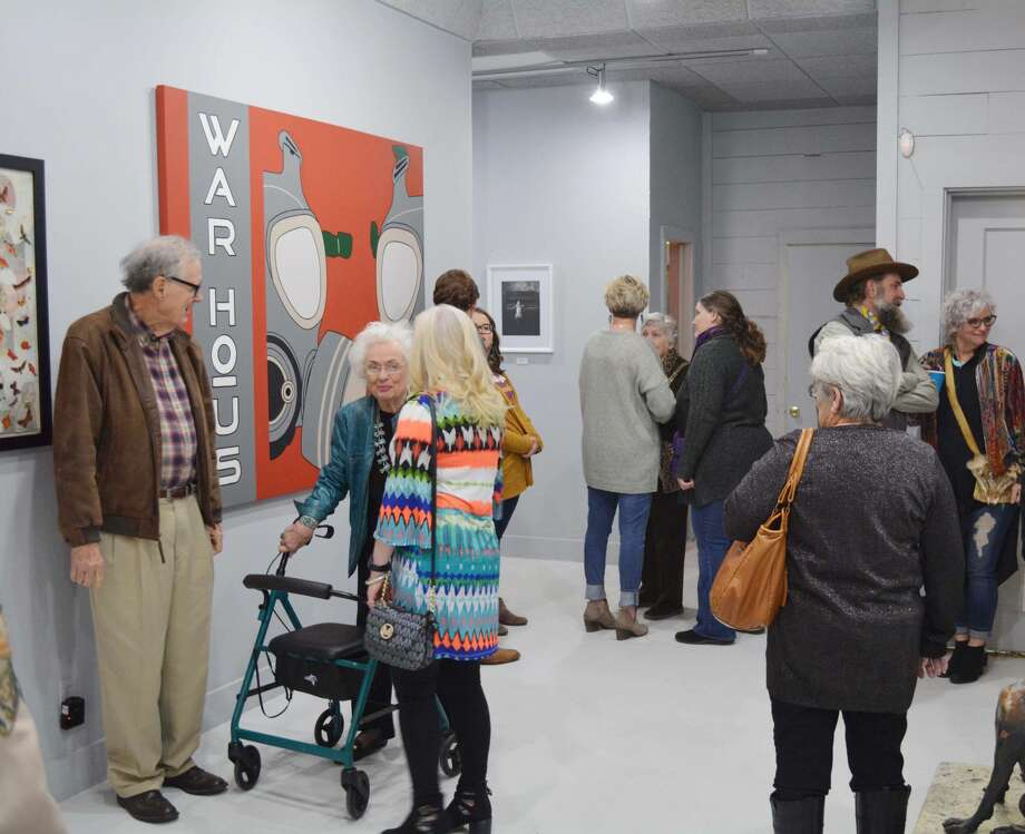 Guests for the grand opening of the Contemporary Art Museum of Plainview spend time talking with their fellow patrons and artists Friday evening. Photo: William Carroll