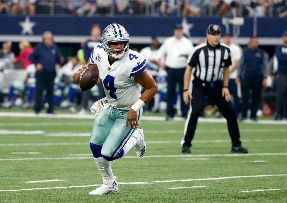 Dallas Cowboys quarterback Dak Prescott scrambles during an Oct. 8, 2017 game in Arlington, Texas. Photo: Michael Ainsworth /AP Photo