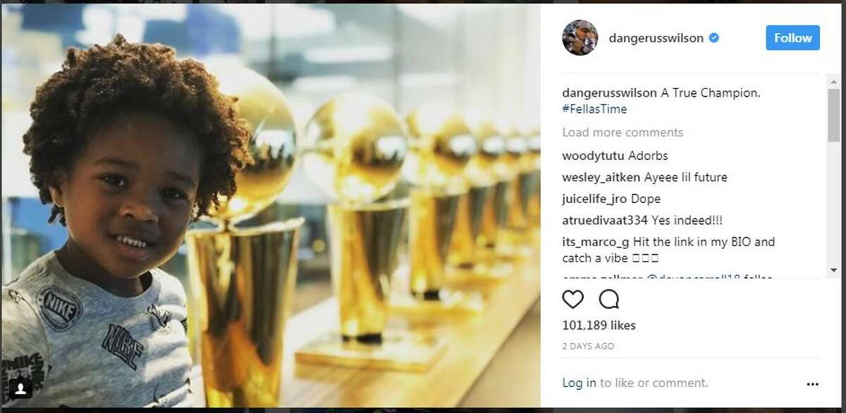 Future, the son of Seahawks QB Russell Wilson's wife, Ciara, poses with Larry O'Brien championship trophies at the Los Angeles Lakers practice facility.