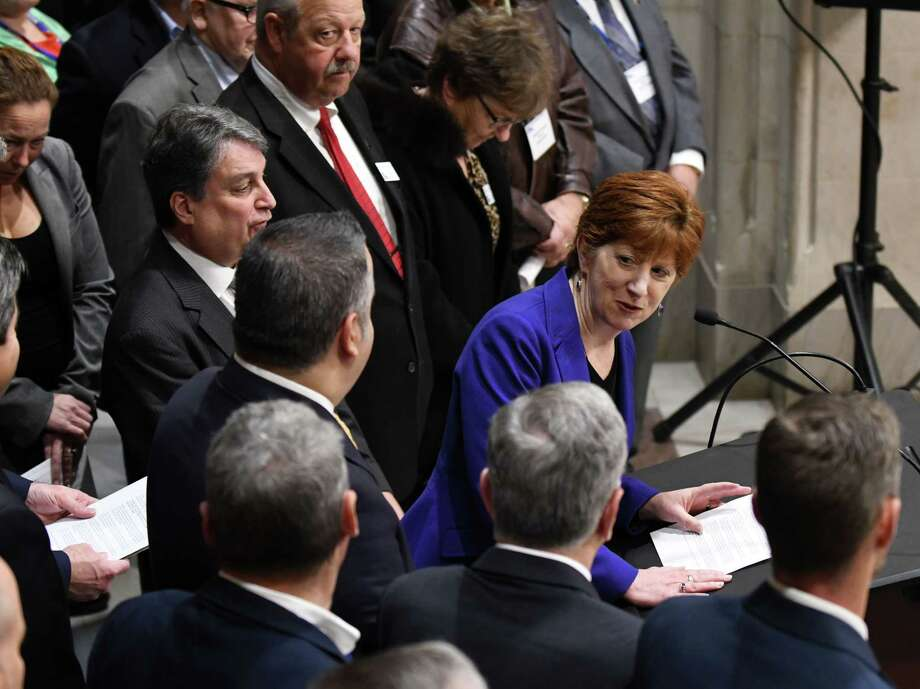 Mayor Kathy Sheehan is joined by mayors from across the state to express their concerns about elements of the federal tax reform proposal that would include elimination of the State and Local Tax (SALT) Deduction on Monday, Nov. 13, 2017, at City Hall in Albany N.Y. The mayors came to Albany to attend a New York State Conference of Mayors meeting. (Will Waldron/Times Union) Photo: Will Waldron, Albany Times Union / 20042118A