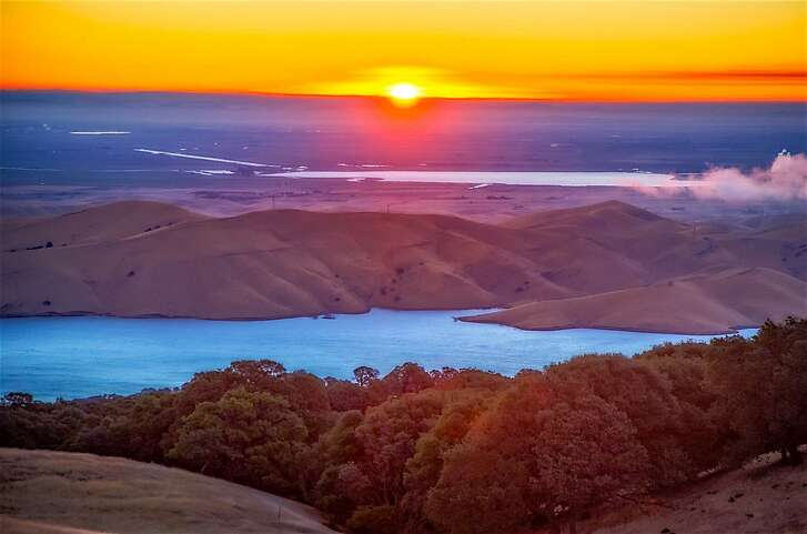 Sunrise over Los Vaqueros Reservoir, nestled in the East Bay hills between Livermore and Brentwood. The lake is 93 percent of its new, huge capacity, and is reborn as a refuge for fish and wildlife.