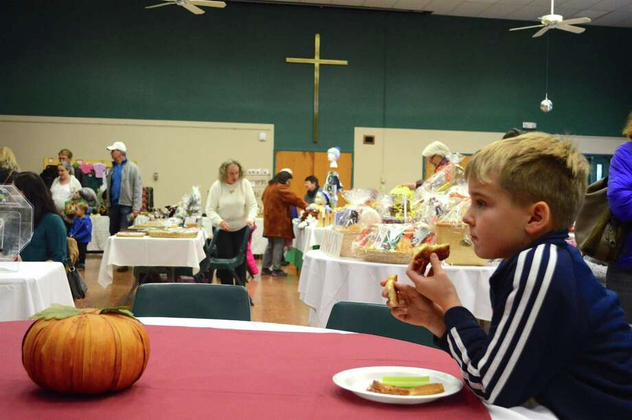 Aidan O'Connell, 9, of Westport, enjoys a grilled cheese sandwich at the annual Harvest Fair at St. Luke Parish, Saturday, Nov. 11, 2017, in Westport, Conn. Photo: Jarret Liotta / For Hearst Connecticut Media / Westport News Freelance