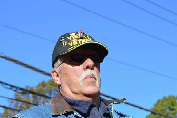 Vietnam veteran Andre Kalapir of Fairfield listens to the proceedings at the annual Veterans Day ceremony at the Memorial Honor Wall at Town Green, Saturday, Nov. 11, 2017, in Fairfield, Conn.