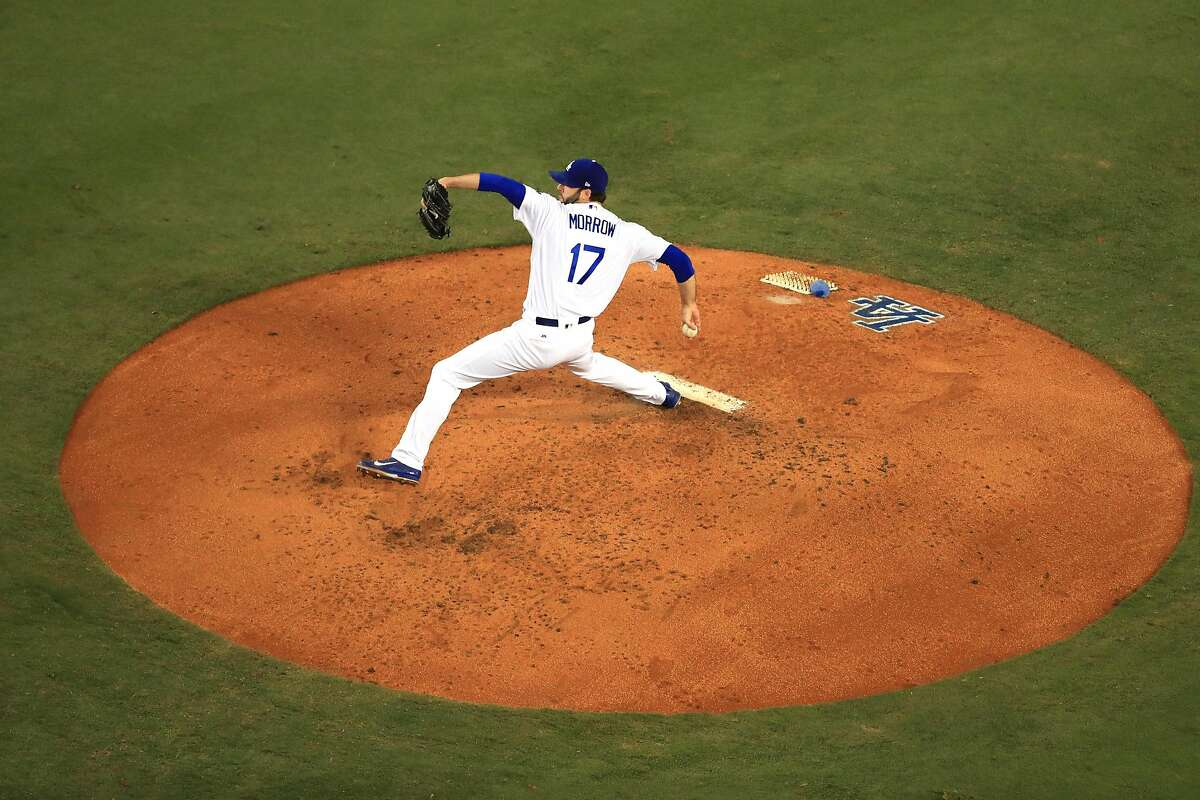 LOS ANGELES, CA - NOVEMBER 01: Brandon Morrow #17 of the Los Angeles Dodgers pitches during the second inning against the Houston Astros in game seven of the 2017 World Series at Dodger Stadium on November 1, 2017 in Los Angeles, California. (Photo by Sean M. Haffey/Getty Images)