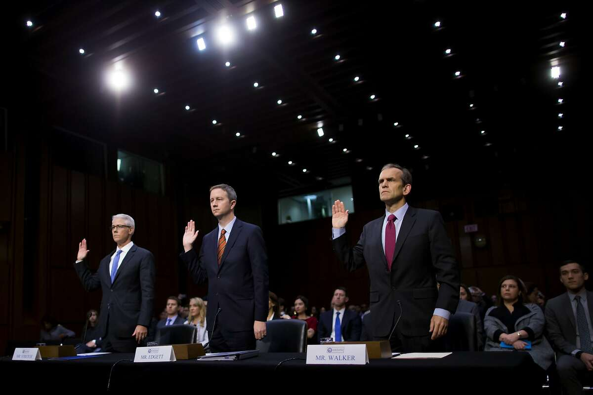 From left: Colin Stretch, general counsel of Facebook; Sean Edgett, acting general counsel of Twitter; and Kent Walker, senior vice president and general counsel of Google, testify at a Senate Intelligence Committee hearing examining social media influence in the 2016 elections, in Washington, Nov. 1, 2017. How a small group of self-made experts came to advise Congress on disinformation campaigns is a testament to just how long tech companies have failed to find a solution to the problem.