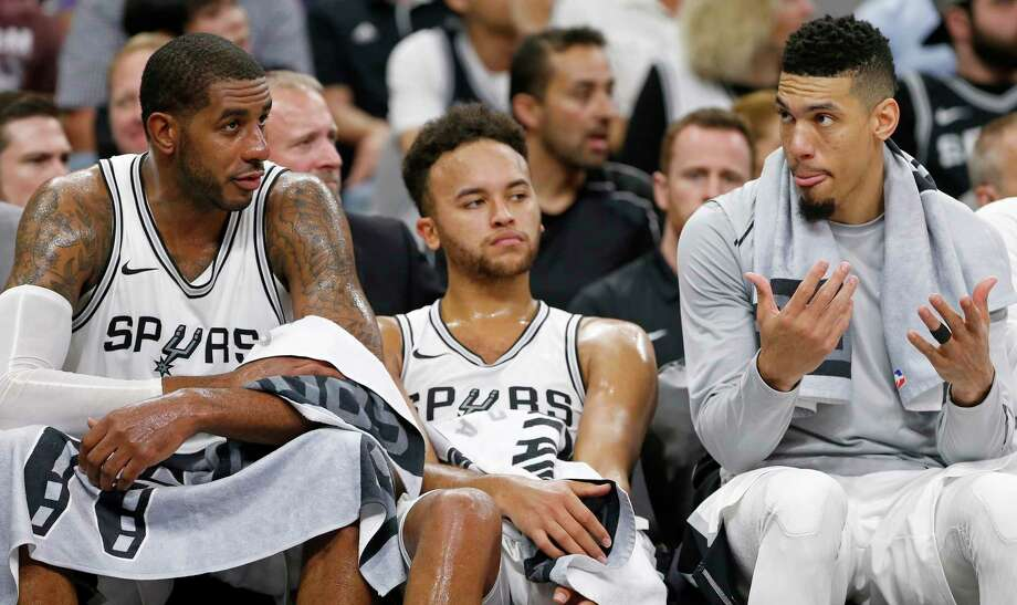 San Antonio SpursÕ LaMarcus Aldridge (from left) Kyle Anderson, and Danny Green sit on the bench late in second half action against the Golden State Warriors Thursday Nov. 2, 2017 at the AT&T Center. The Warriors won 112-92. Photo: Edward A. Ornelas, San Antonio Express-News / © 2017 San Antonio Express-News