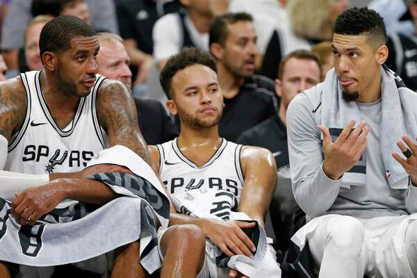San Antonio SpursÕ LaMarcus Aldridge (from left) Kyle Anderson, and Danny Green sit on the bench late in second half action against the Golden State Warriors Thursday Nov. 2, 2017 at the AT&T Center. The Warriors won 112-92.