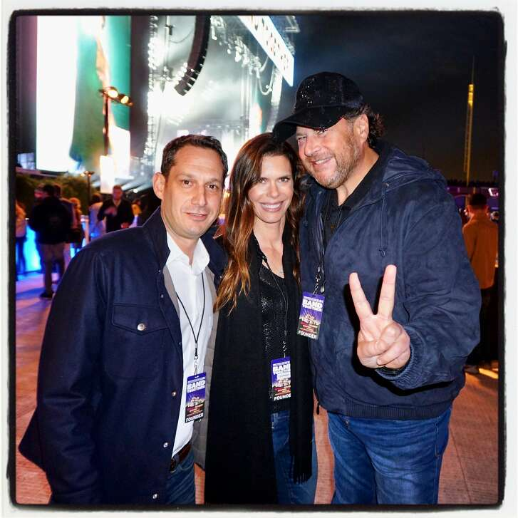 Tipping Point CEO Daniel Lurie (left) with philanthropist Lynne Benioff and her husband, Salesforce CEO Marc Benioff at AT&T Park for Band Together. Nov. 9, 2017.
