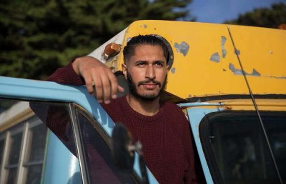 UC Berkeley junior Hash Khan lives in a school bus. Photo: Joshua Jordan/Daily Cal