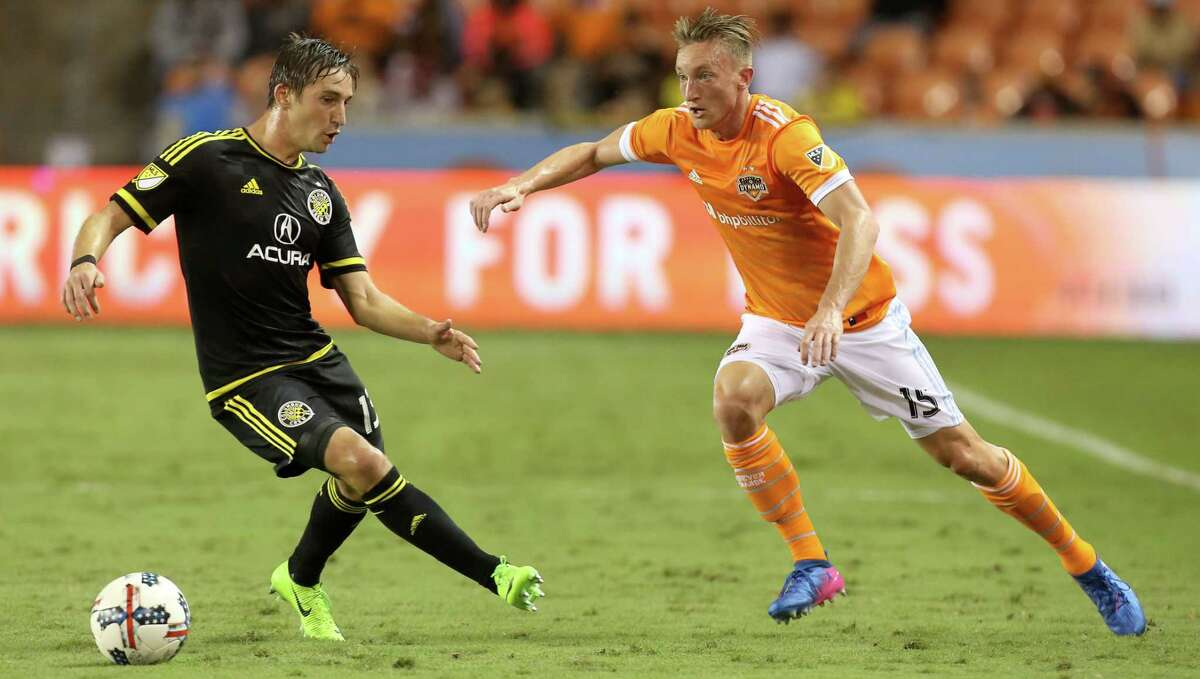 Houston Dynamo defender Dylan Remick (15) passes the ball to teammates during the first half of the MLS soccer game against the Columbus Crew at BBVA Compass Stadium Saturday, March 11, 2017, in Houston. The Dynamos defeated the Crew 3-1. ( Yi-Chin Lee / Houston Chronicle )