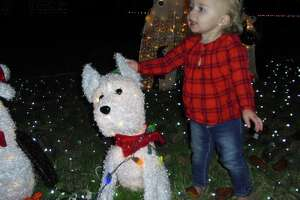 Kaleigh Murphree visits the holiday display in her front yard in Katyland.