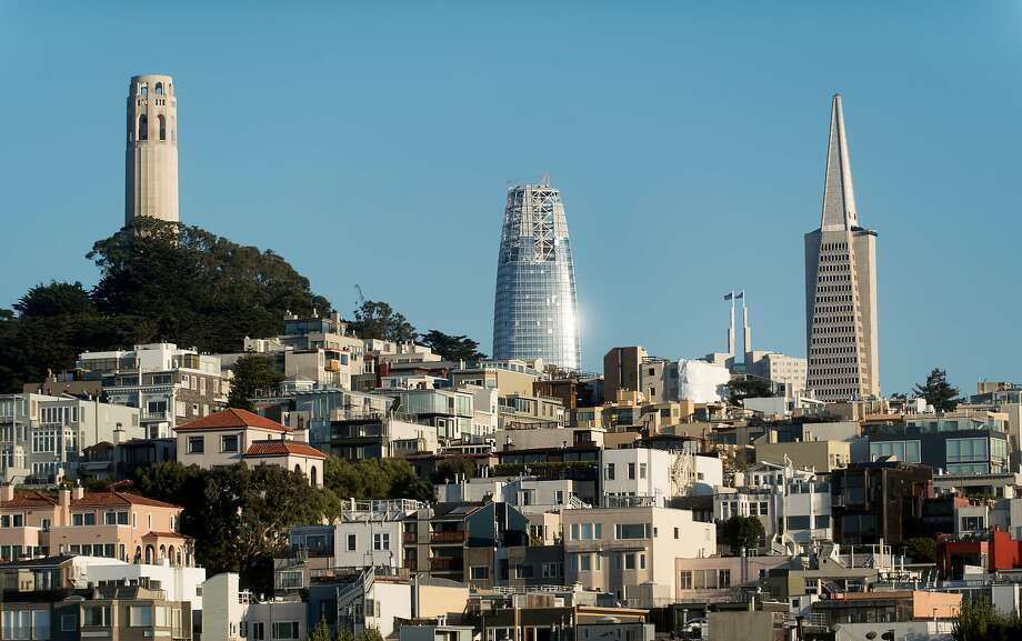 Salesforce Tower, flanked in the foreground by Coit Tower and the Transamerica Pyramid, rises high. Photo: Noah Berger, Special To The Chronicle