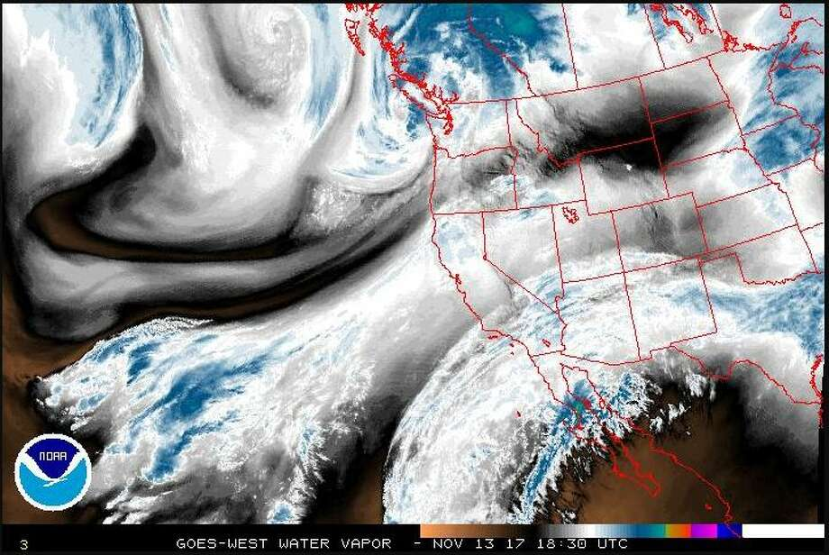 A satellite image from late Monday morning shows the storm system moving into Western Washington from the northwest. The system is set to bring winds up to 65 mph and heavy rains across the region. In the mountains, the storm is set to dump up to 3 feet of snow. Photo: National Weather Service