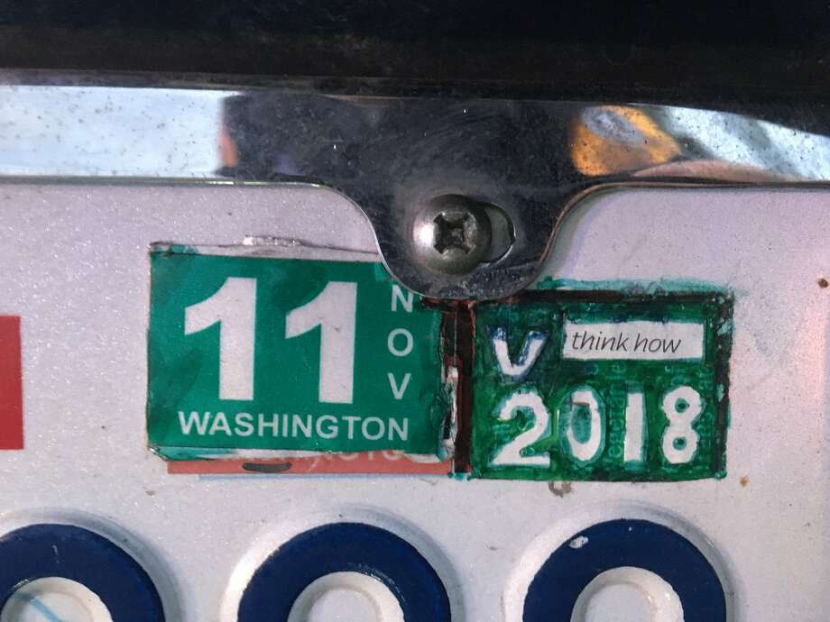 This was one Washington driver's artistic touch to their car tabs failed to impress a state trooper. But if the person balked at the new high car tab fees they weren't alone – legislature's attempts to lower the fees is hitting a snag. Photo: WSP