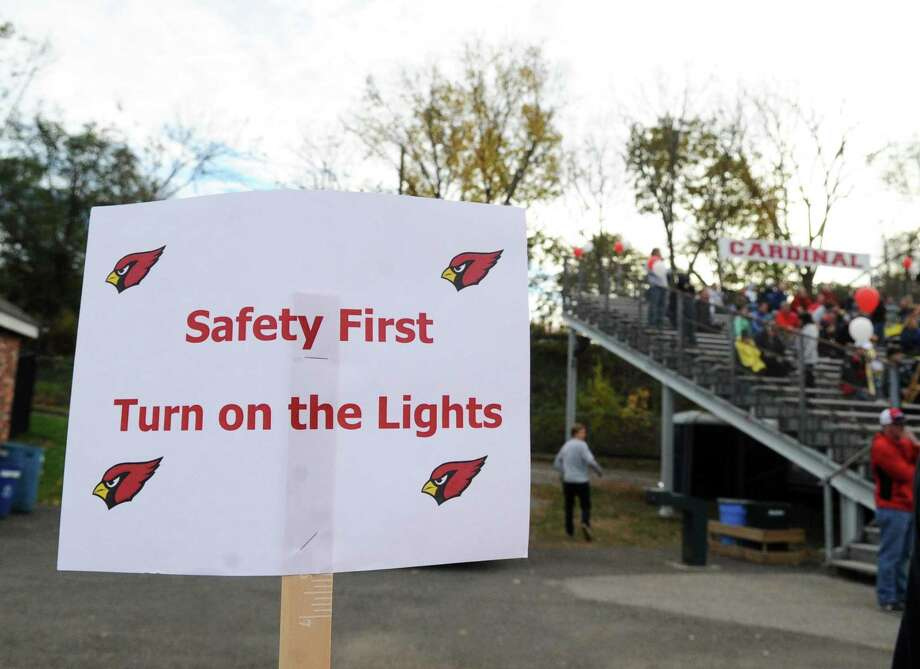 "A sign attached to a fence reads ""Safety First Turn on the Lights,"" during the high school football game between Greenwich High School and Ridgefield High School at Cardinal Stadium in Greenwich, Conn., Saturday, Nov. 4, 2017. Greenwich remained undefeated winning the game 26-21 over Ridgefield. Photo: Bob Luckey Jr. / Hearst Connecticut Media / Greenwich Time"