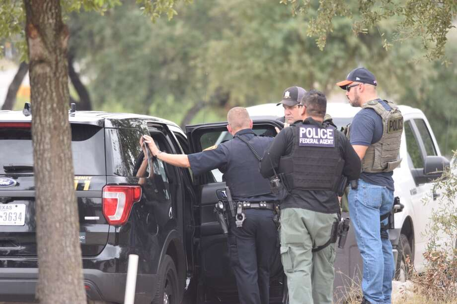 Agents with the Lone Star Fugitive Task Force on Monday found a suspect in the July shooting of a police officer in the wall of a Northwest Side home. Photo: Caleb Downs / San Antonio Express-News