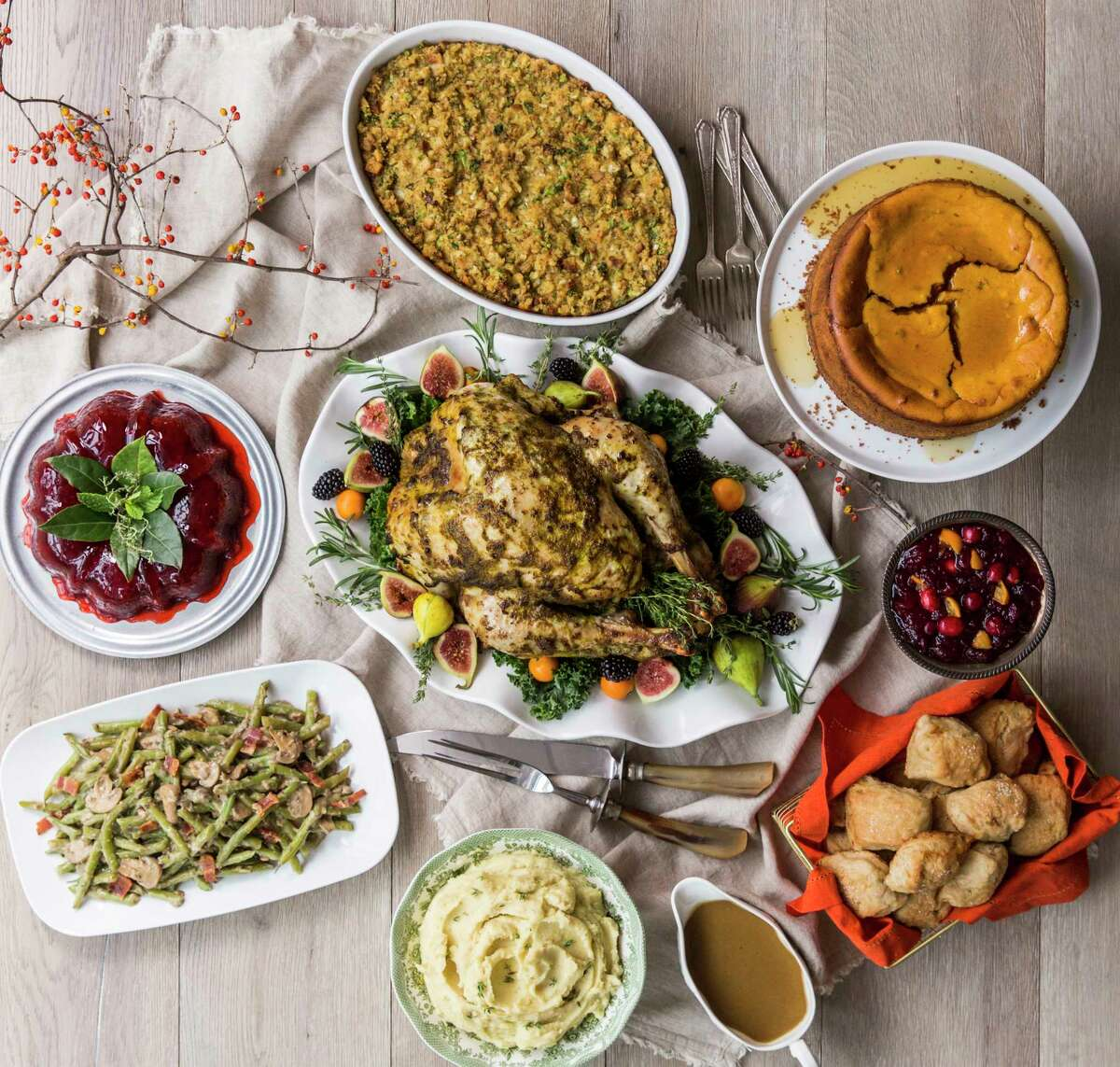 Herb Roasted Turkey in Three Steps and Perfect Turkey Gravy with sides including One Hour Rolls, Green Beans Oregano, Pumpkin Cheesecake, Mashed Potatoes, Cherry Brandy Mincemeat Mold and Grandmother's Favorite Dressing. Styled by Carla Buerkle.